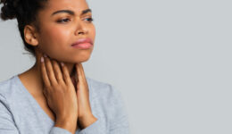 Sad Black Woman Suffering From Pain In Throat, Touching Her Neck