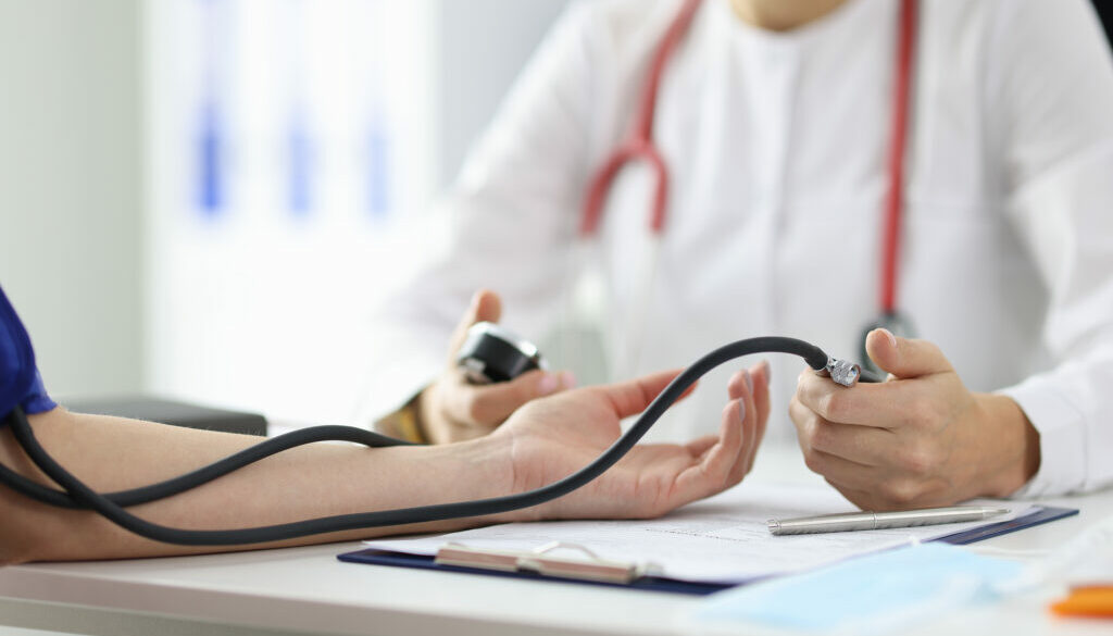 Physician Therapist Measures Patients Pressure. High Blood Press